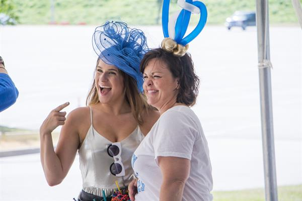 E-Day at the K: Molly Balloons creates balloon hat couture for Jenny Miller