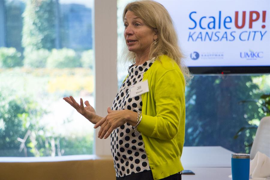 Jill Meyer converses with a business owner in the ScaleUP! Kansas City program