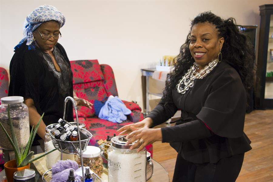 Serial entrepreneur Gigi Jones helps a customer at her small business Zafar