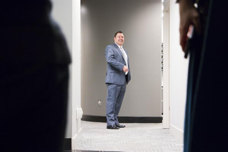 Joe Vazquez of Vazquez Commercial Contracting looks down the hall of his business' headquarters in Kansas City, Missouri