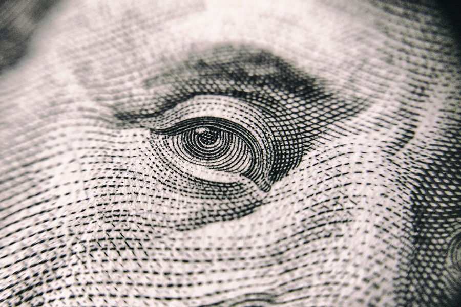 Closeup of eye of Benjamin Franklin on the $100 bill