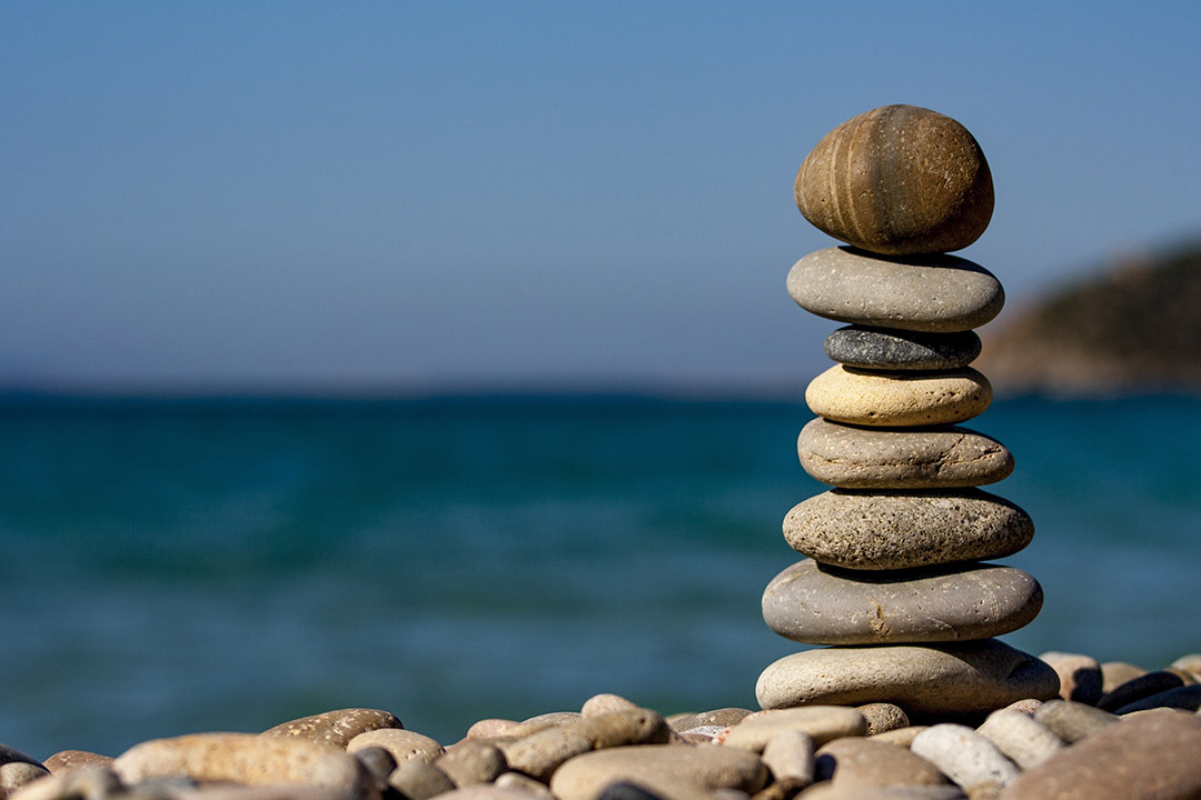 A stack of balancing rocks on a shoreline