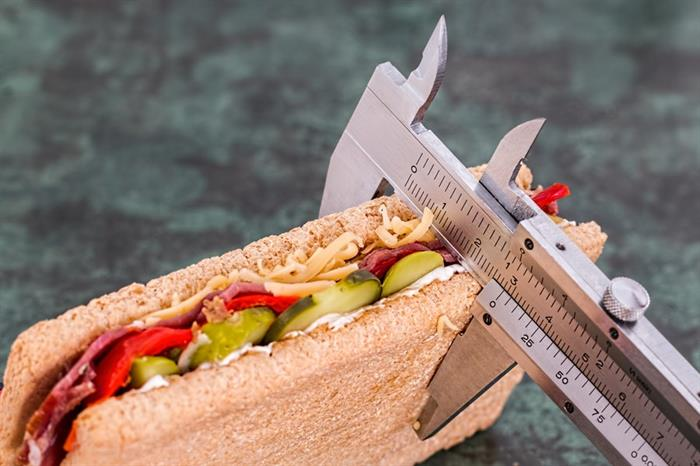 A sandwich is measured with calipers