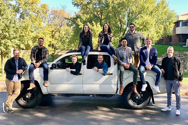 Team from Bungii poses on a pickup truck