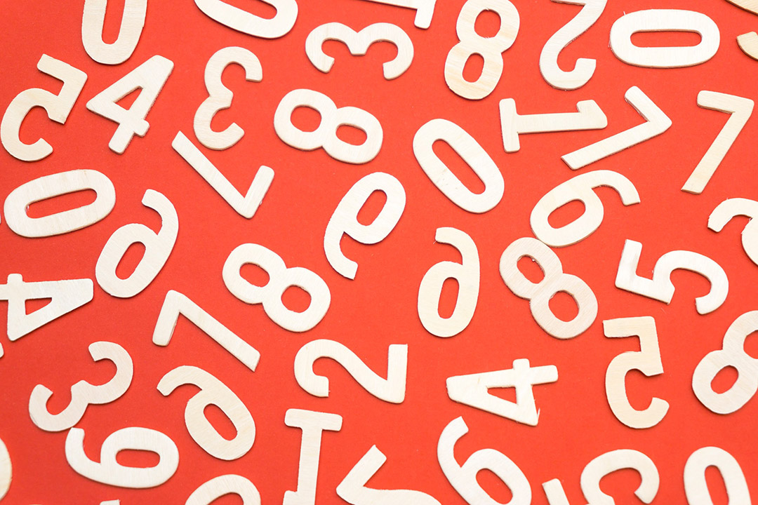 white numbers scattered on a red background
