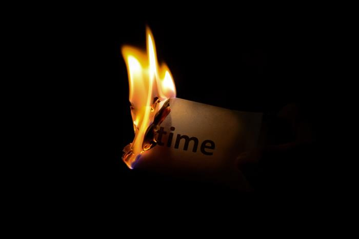 "A piece of paper with the word ""time"" on it burns"