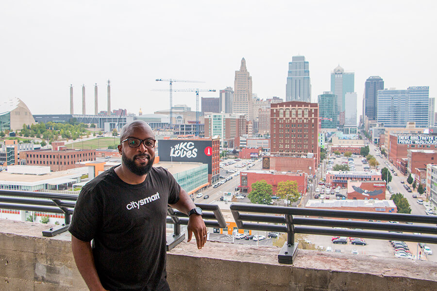 Donald Hawkins of CitySmart poses in front of the Kansas City skyline