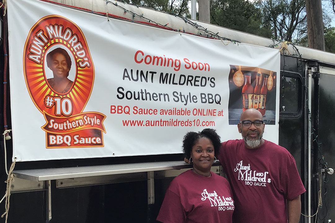 Earstin and Penelope Sanders pose outside Aunt Mildred's Barbecue Mobile Eatery