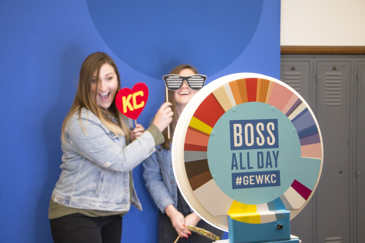 GEWKC 2018 attendees pose for a picture at a photo station