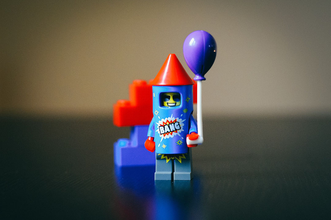 A Lego figure in a rocket costume