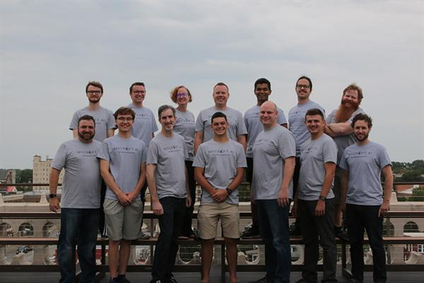 The Mycroft team poses on a Kansas City rooftop for a photo