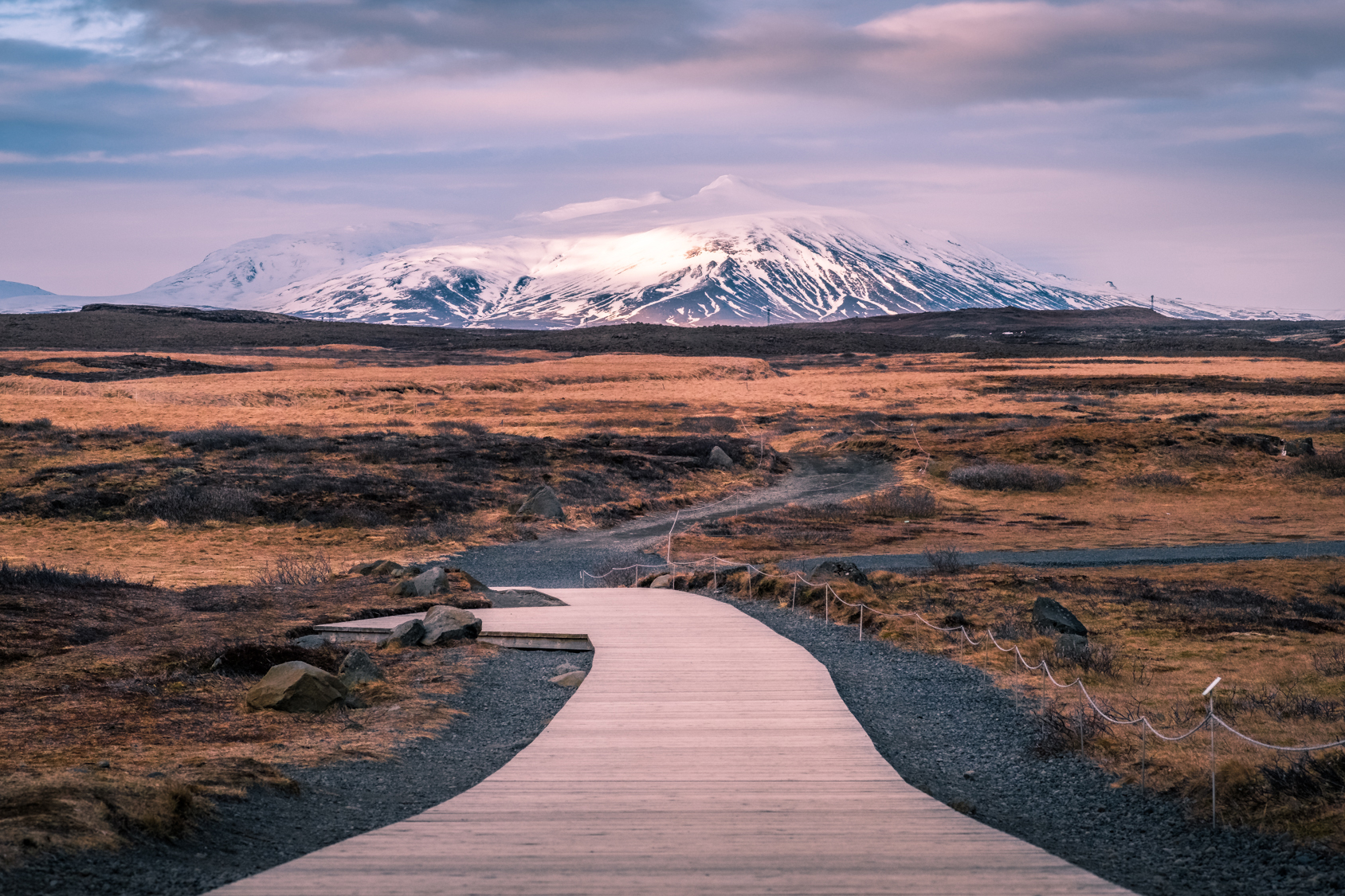 path toward snow-capped mountain