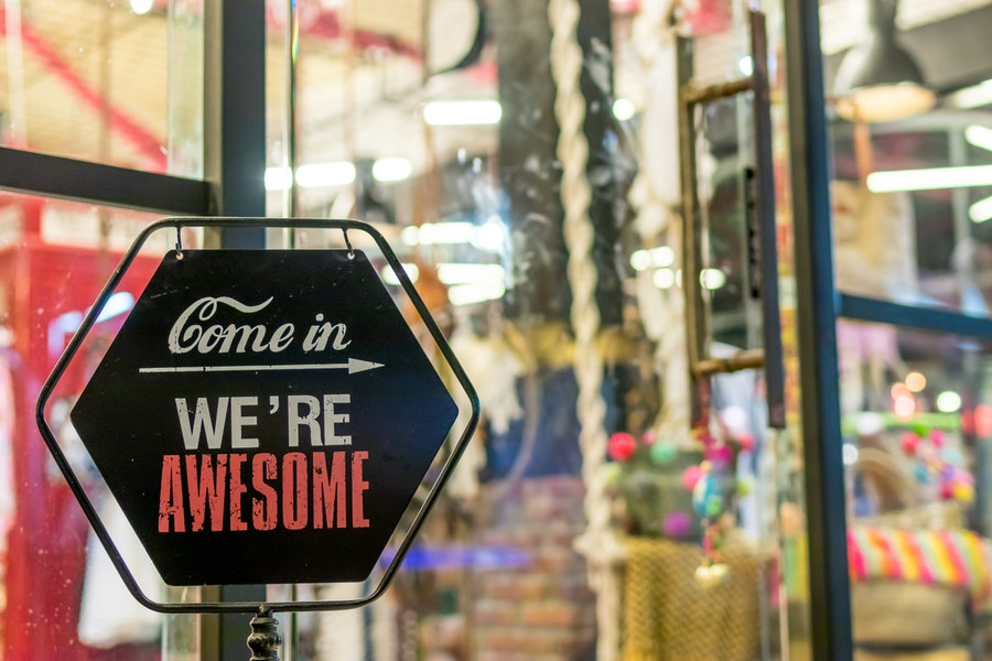 Small Business Saturday: Sign outside a small business inviting customers to come inside