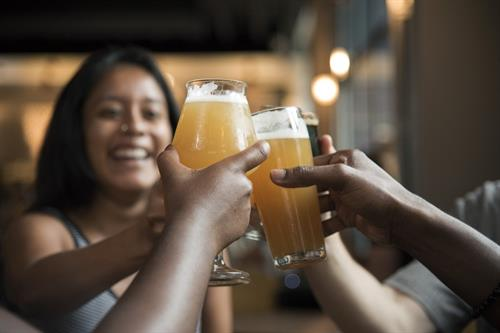 People raise beer glasses