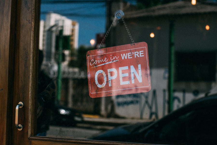 open sign in a window of a small business