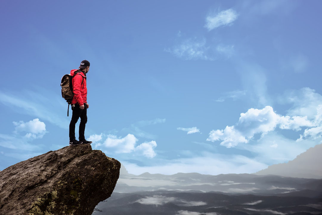 A person on top of a mountain